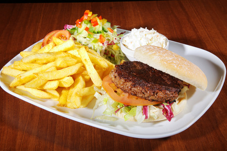 Hamburger with french menu on white plate Stock Photo