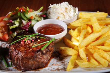 steak with french fries and sauce Stock Photo