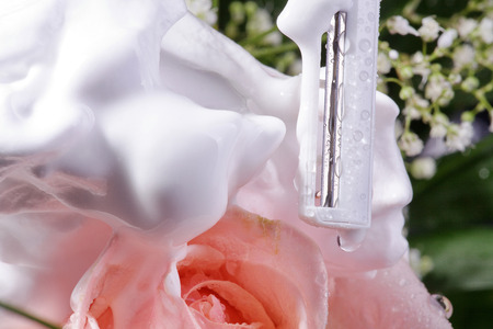 razor decorated with roses and water photo