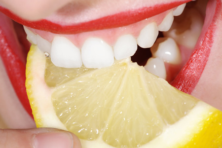 close-up woman model with white teeth and lemon