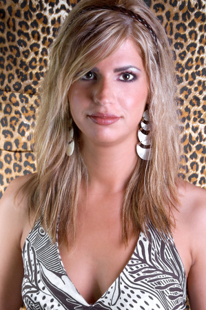 fashion model with tiger skin background