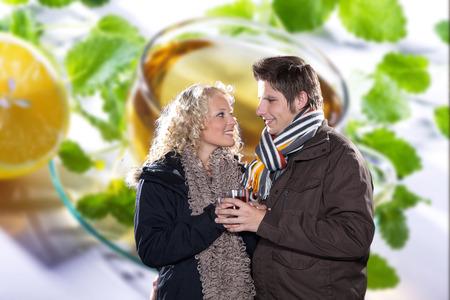 beautiful couple drinking tea in winter look