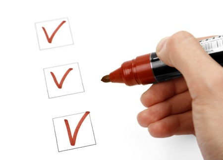 Hand with marker and check list Stock Photo - 17700937