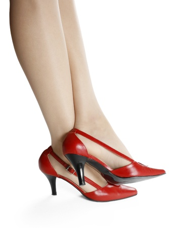 Slim legs and red shoes isolated on white background  photo