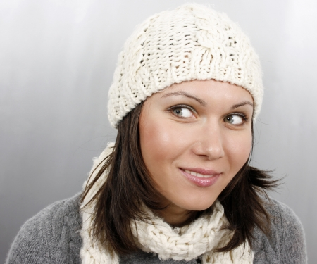 Beautiful woman in cap and scarf Stock Photo - 17645373