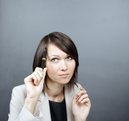 Businesswoman holding a pen Stock Photo - 17645366