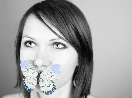 Beautiful woman with a butterfly on lips Stock Photo - 17645377