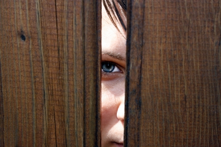 Eye behind wooden fence staring Stock Photo - 17718117