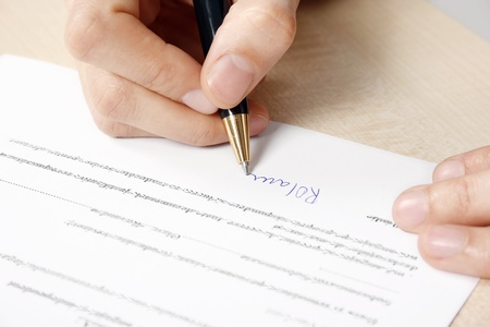 Businesswoman signing the contract