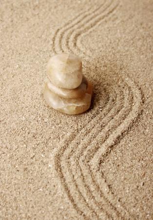 Zen stones in the sand photo