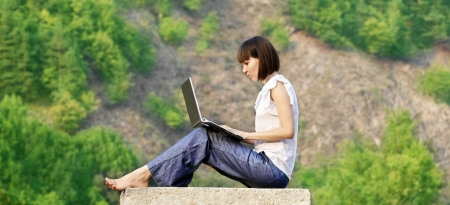 Young woman student learning in the nature Stock Photo
