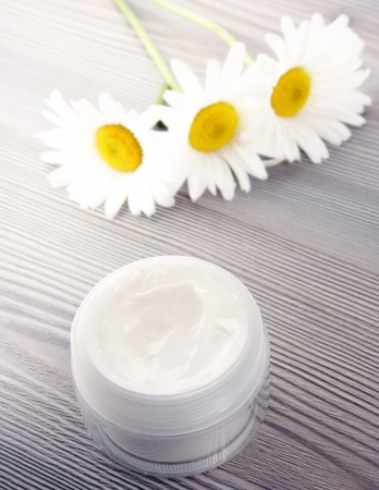 Beauty treatment and white daisies photo
