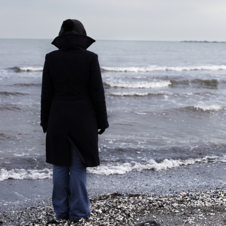 Lonely person on a beach in winter time