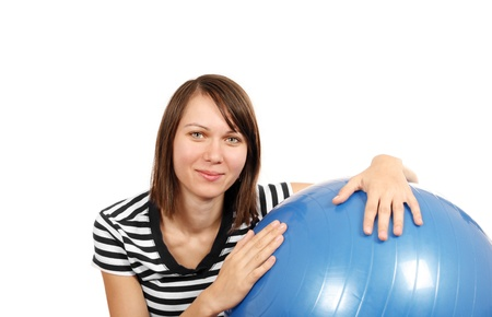 Young woman with gym ball isoated on white background Stock Photo - 17718091