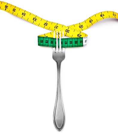 Fork and measuring tape  on white background Stock Photo - 17708098
