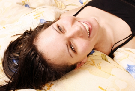 Happy woman in bed photo