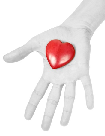 doctor holding gift: Woman giving a red heart