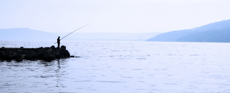 Man fishing in the sea photo