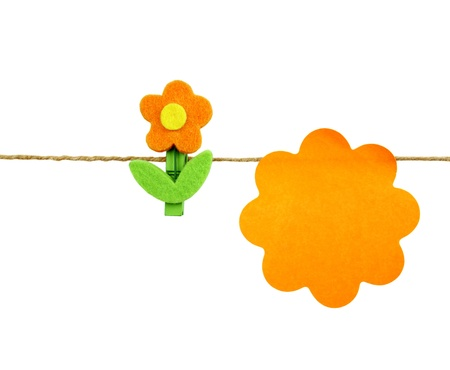 detriment: Orange post it and flowers isolated on white background