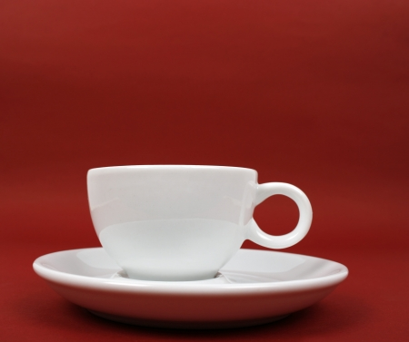 Cup of coffee on red background Stock Photo - 17829168