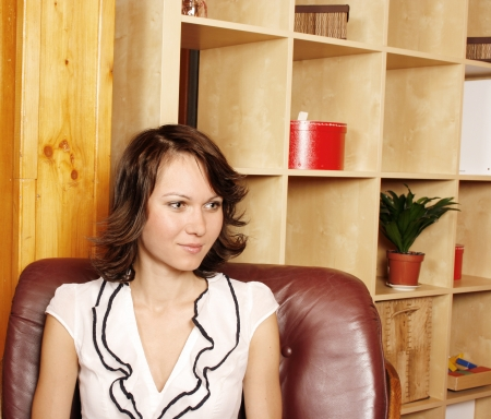 Beautiful young woman in her office