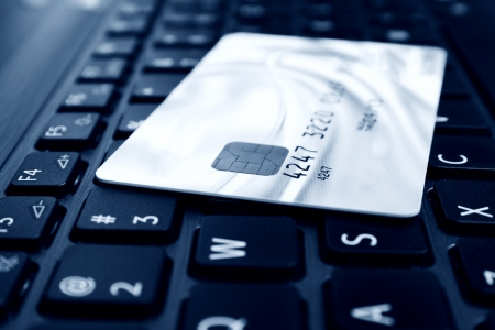 Credit card on keyboard Stock Photo