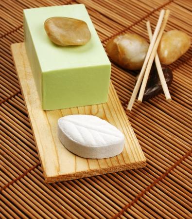 Nice spa arrangement with soap, bath salt and stones photo