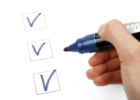 Hand with marker and check list Stock Photo