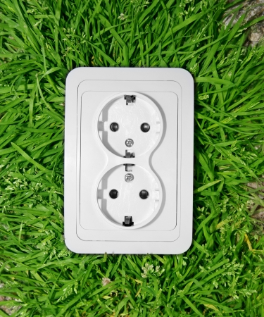 Power outlet in green grass