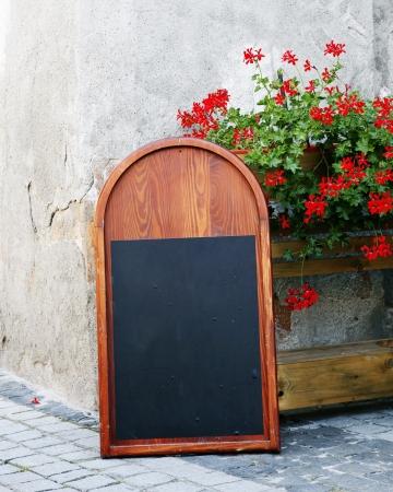 A blank blackboard in the street Stock Photo