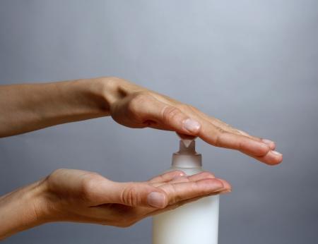 Woman applying liquid soap