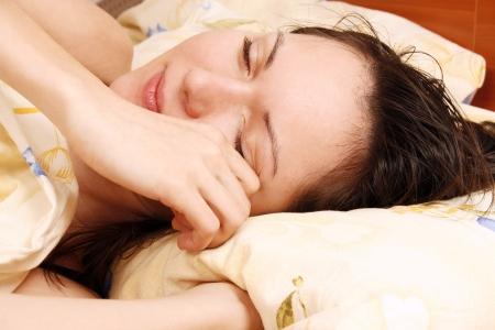 awaking: Young beautiful woman awaking Stock Photo