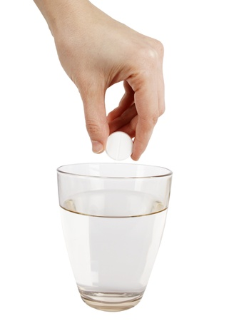 Effervescence tablet and a glass of water isolated on white background Stock Photo - 18072989