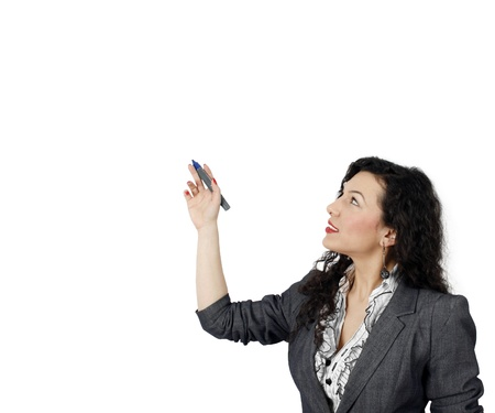 Confident woman presenting information on a whiteboard