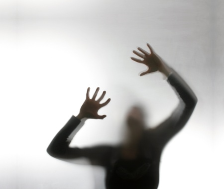 Silhouette of a screaming woman   photo