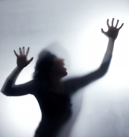 anger abstract: Silhouette of a sreaming woman