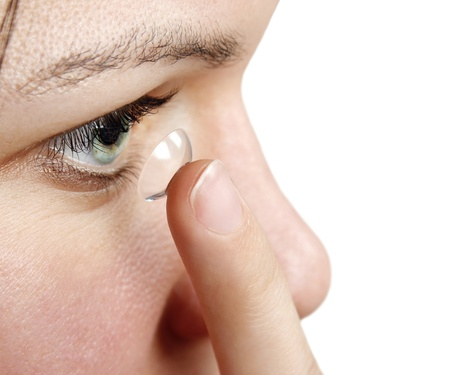 Woman inserting a contact lens