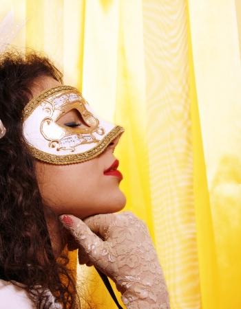 Beautiful woman wearing a carnival venetian mask   photo
