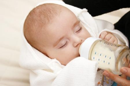 Beautiful baby drinking milk