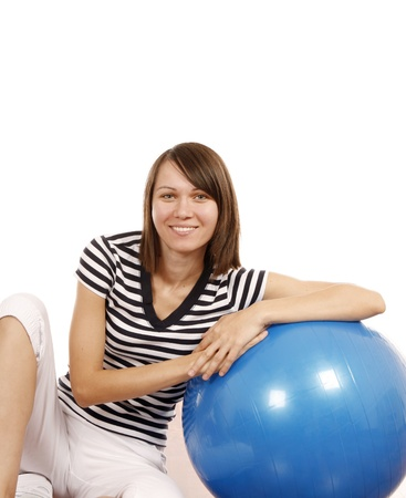 Young woman with gym ball isoated on white background Stock Photo - 18105062