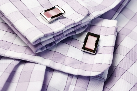 Close-up of cufflinks on men�s checkered shirt photo