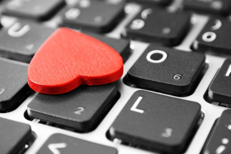 Red heart on the computer keyboard Stock Photo