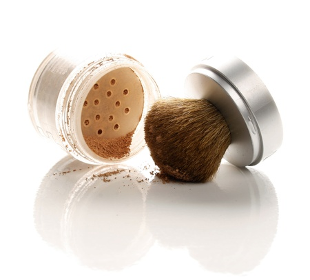 Makeup powder and brush on white background Stock Photo