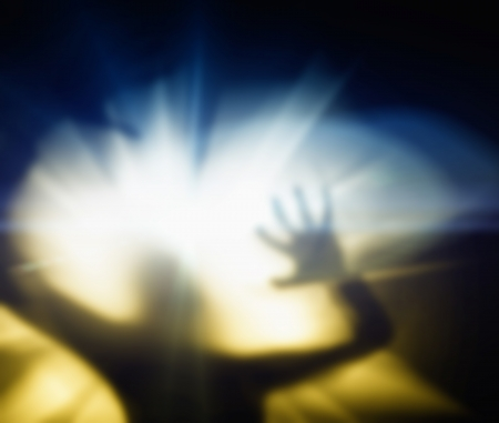 Silhouette of a screaming woman Stock Photo