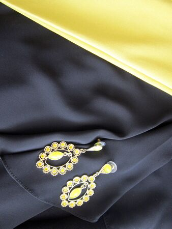 yellow navy blue fabric on the precious jewelry.