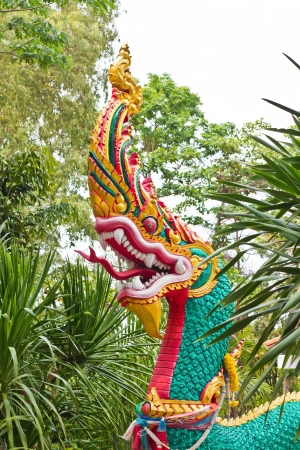 a photo of statue naga in thai temple photo