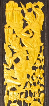 Thai design craft on wooden door photo