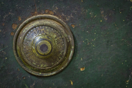 the old and grunge vintage dial key lock safe photo