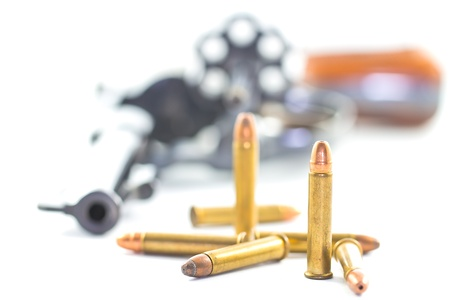 gun and bullets isolated on white background photo