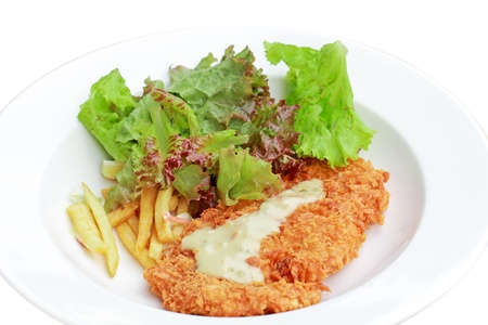 deep fried chicken steak with tomato fried and salad,isolated on white background photo